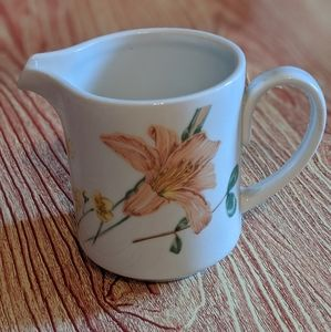 Milk thistle jug with floral print by Mikasa.